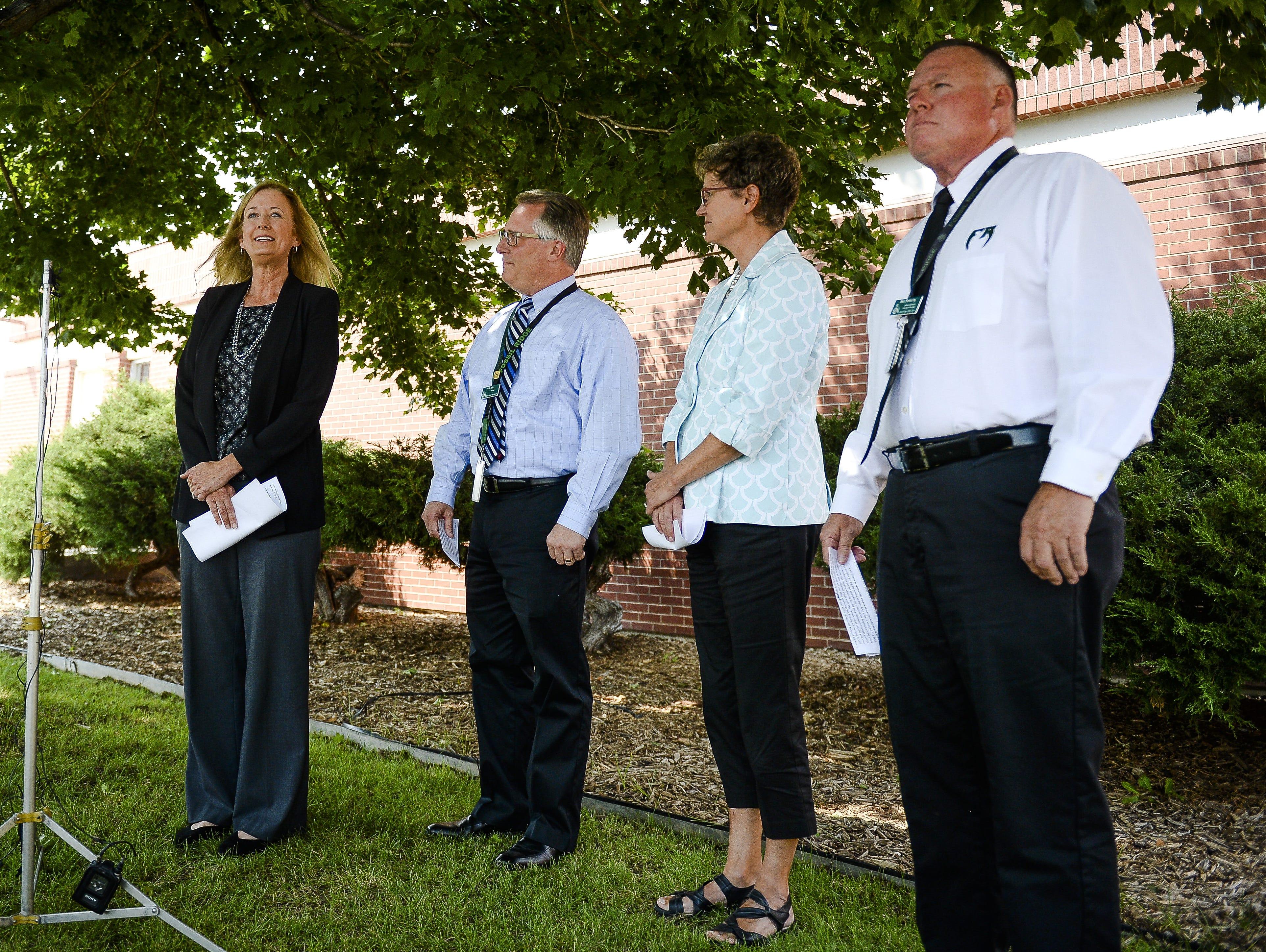 Fossil Ridge High School athletic director Ken Denning, far right, has resigned.