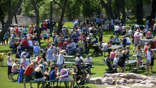 Thousands pack into Falls Park for the annual mayor's Fourth of July picnic in 2013.