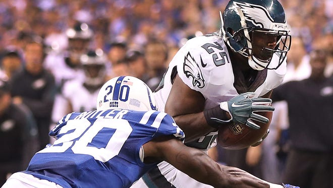 Darius Butler makes the tackle on LeSean McCoy. The Indianapolis Colts play the Philadelphia Eagles Monday, September 15, 2014, evening at Lucas Oil Stadium.