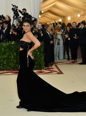 At the 2018 Met Gala on May 7, Jenner's strapless Alexander Wang gown featured an exposed zipper and long train.