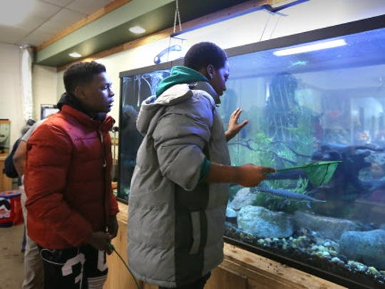 Marcus Webb, 17, an employee at the Urban Ecology Center,