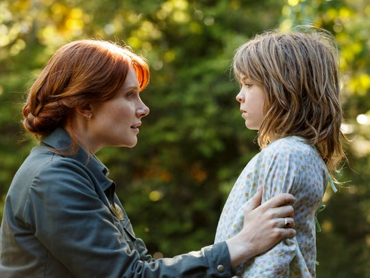 "Bryce Dallas Howard is Grace and Oakes Fegley is Pete in a new version of Disney's 1977 ""Pete's Dragon."""
