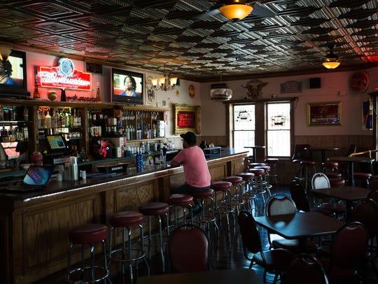 Regular customer to Palacio Bar Greg Martinez watches