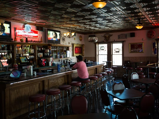 Regular customer to Palacio Bar Greg Martinez watches television and enjoys a beer on Thursday June 30, 2016. Bar has been in business for 80 years in Mesilla, NM.