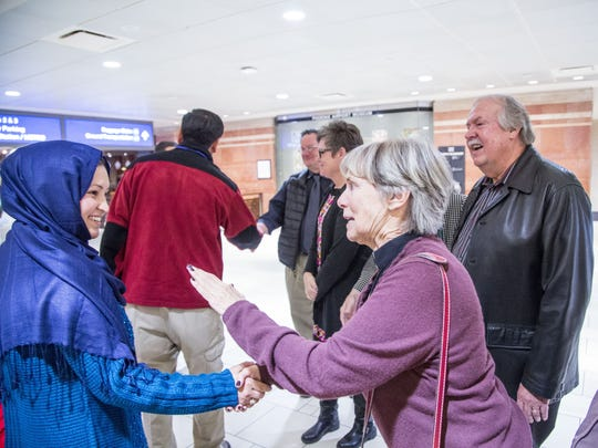 The Rev. Jayne Baker (center) of Ascension Lutheran Church in Paradise Valley welcomes Marzia Safdari, a Afghanistan refugee, arriving at Sky Harbor International Airport in December 2015.