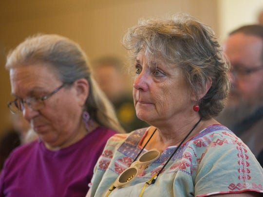 Leilani Horton, right and Susan Beck, left, quietly listen to the name of students, faculty and staff who have passed away this year during a memorial service held in the Spiritual Center at New Mexico State University, Wednesday May 3, 2017.