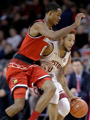 Boston College guard Ky Bowman (0) looks for a way around Louisville forward V.J. King (0) while driving to the basket during the second half of an NCAA college basketball game Saturday, Feb. 4, 2017, in Boston.
