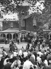 A view of the activity outside of Hollybush in Glassboro during the Hollybush Summit in 1967.