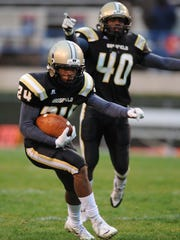 Former Bassfield stars Cornell Armstrong (24) and A.J.