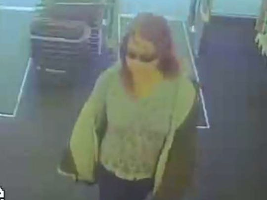 Surveillance images of woman accused of using stolen
