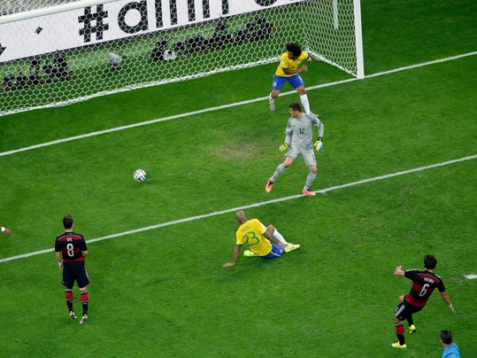 Germany's Sami Khedira, bottom, scores his side's 5th goal during the World Cup semifinal soccer match between Brazil and Germany at the Mineirao Stadium in Belo Horizonte, Brazil, Tuesday, July 8, 2014. (AP Photo/Felipe Dana, Pool)