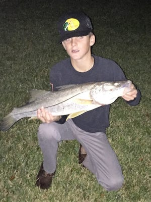 Levi Williamson, 13, of Vero Beach caught his first snook which also was his first keeper snook while fishing at Sebastian Inlet with his dad, Clay Williamson, and Cody Gazda.