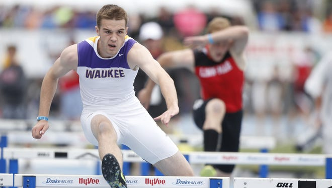 Waukee's Nick Wessels takes the final leg of the 4x110-meter shuttle hurdle relay as Waukee won its third straight title in the event and defended its Class 4-A team championship Saturday.