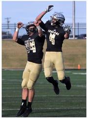 Comanche High School's Jeremy Bostick (left) congratulates