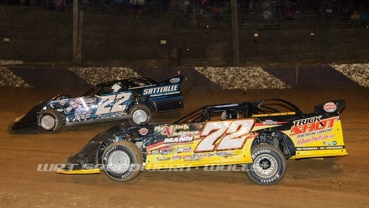 Jason Covert (72) battles with Gregg Satterlee (22) for teh lead Monday night at Path Valley. Covert won the Late Model Speedweek event.