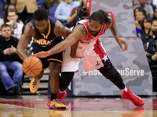Solomon Hill (44) of the Indiana Pacers and Nene Hilario (42) of the Washington Wizards go after a loose ball Nov. 5, 2014, during the first half at the Verizon Center in Washington, D.C.