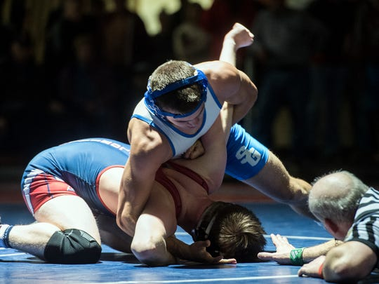 Spring Grove's Brady Pitzer, right, tries to turn New Oxford's Kinser Laughman during the 160-pound bout. Pitzer won by tech fall, Tuesday, Jan. 23, 2018. The Spring Grove Rockets beat the New Oxford Colonials, 36-25, to climb to the top of Division I.
