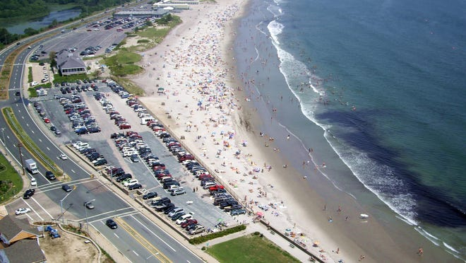 Narragansett Town Beach and Pavilion are seen in this aerial photo by Nate Bousquet of Don Bousquet and Son Aerial Photography. The beach stretches up to Canonchet Beach and Beach Club, near the top; above that, the mouth of the Narrow River and the Dunes Club.