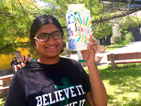 """Harshini Murali, 15, made this birdhouse for the West Bloomfield High School garden of hope. Its message is: """"I was not born to be forced,"""" by Henry David Thoreau."""