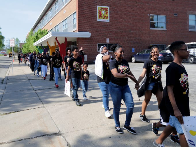 Milwaukee College Prep students march from the 36th