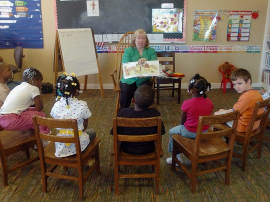 Sept. 20, 2007 -- Kindergarten teacher Patty Terry reads a story to her class at Montgomery Christian School in Trinity Presbyterian Church.