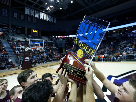 The Mountain Grove Panthers hoist the Blue Division