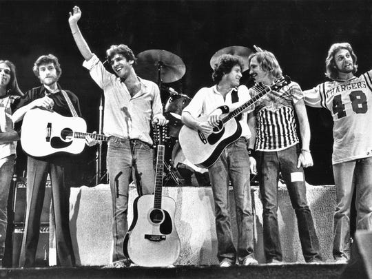 The Eagles take a concert bow with songwriter J.D. Souther, second from left, during a fundraiser for Gov. Jerry Brown at the San Diego Sports Arena in 1979. Pictured from left are Timothy Schmit, Souther, Glenn Frey, Don Henley, Joe Walsh and Don Felder.