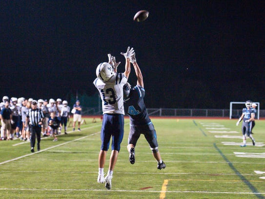 Burlington's Tenzin Kelley, left, catches a touchdown
