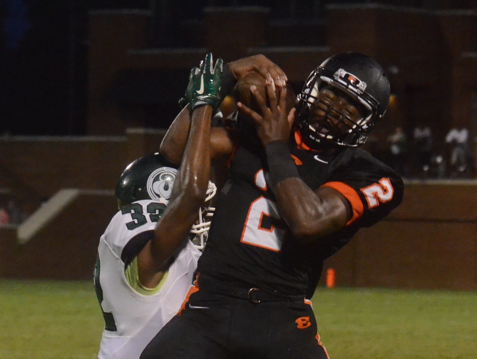 Ensworth's Rodney Owens (2) hauls in a long second-quarter reception during Friday's game against Trinity.