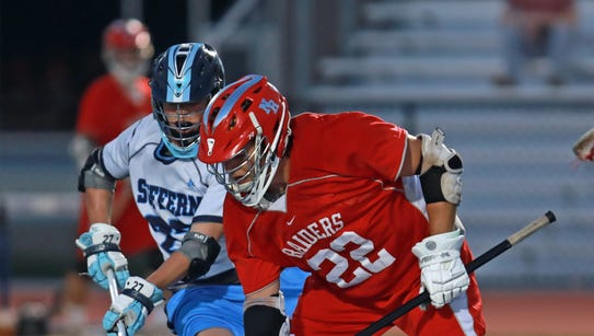 Suffern Mikey Ryan (27) and  North Rockland's Jack