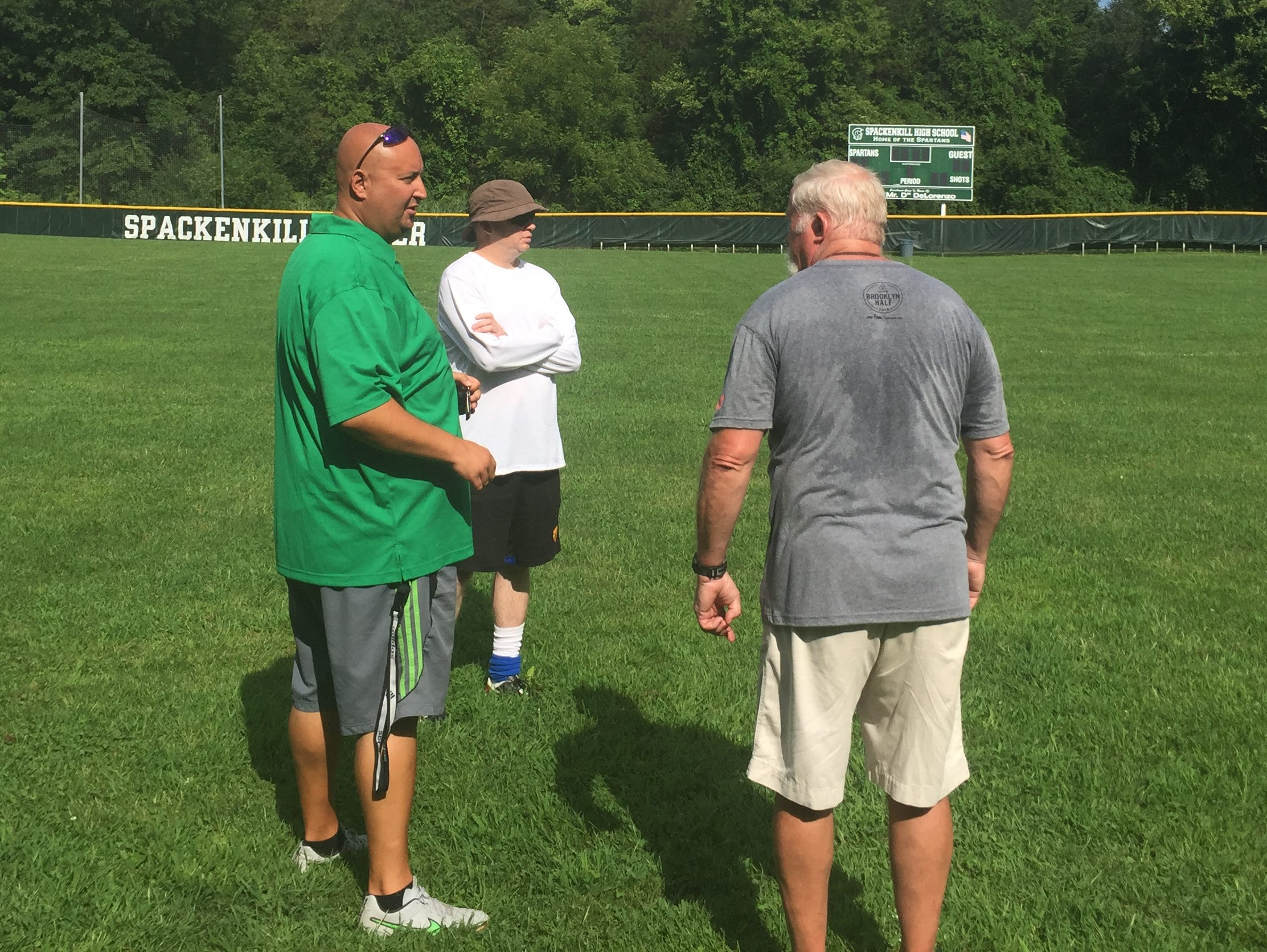 Spackenkill High School boys soccer coach Manny Blanco, left, talks with girls soccer coach Mike Corbett, right, at preseason practice on Monday.