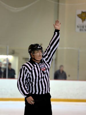 Scott Farquhar signals an icing call during a Silver Stick hockey game Saturday, Jan. 9, 2016 at McMorran Pavilion. Farquhar is calling it quits after 36 years of officiating.