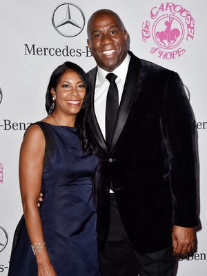 Cookie Johnson  and Earvin 'Magic' Johnson attend the 2014 Carousel of Hope Ball.