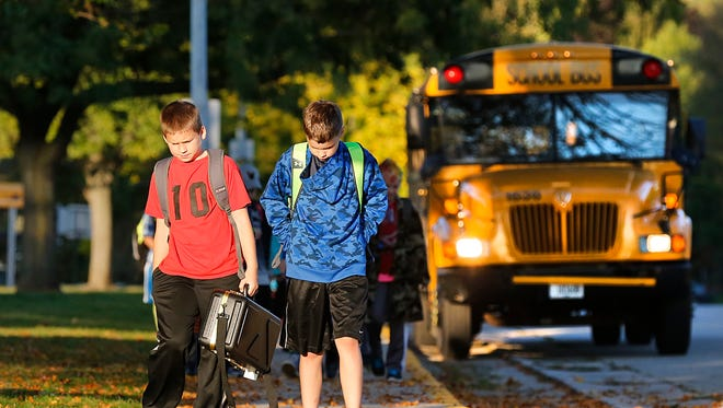 As Wisconsin lawmakers develop and propose measures that allow guns on school campuses, many school district leaders in Fond du Lac County are nervous. Allowing weapons on school property creates a dangerous situation, said James Sebert, superintendent of the Fond du Lac School District. In the photo, Waupun students exit a school bus.