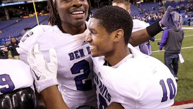 Ben Davis Asmar Bilal,left, calibrates with Chaz Stringer,right, following their game.  Giants defeated Carmel Greyhounds 42-24 in the IHSAA Class 6A State Football Championship game Friday, November 28, 2014, evening at Lucas Oil Stadium.