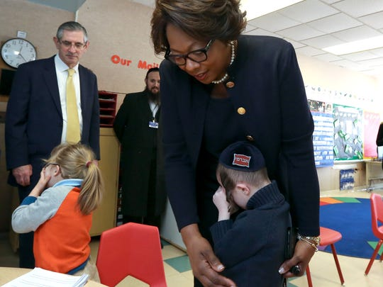 East Ramapo Schools Superintendent Dr. Deborah Wortham comforts a shy student during a visit to a Yiddish bilingual special education program at Elmwood Elementary School in Monsey Feb. 16, 2017.