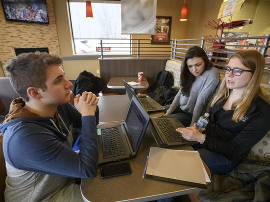 Simon Diratzouyan, from left, Eva Petkov and Julia Ketelhut are students from the International Academy of Macomb. Their school was ranked the top magnet school in the nation by U.S. News & World Report.