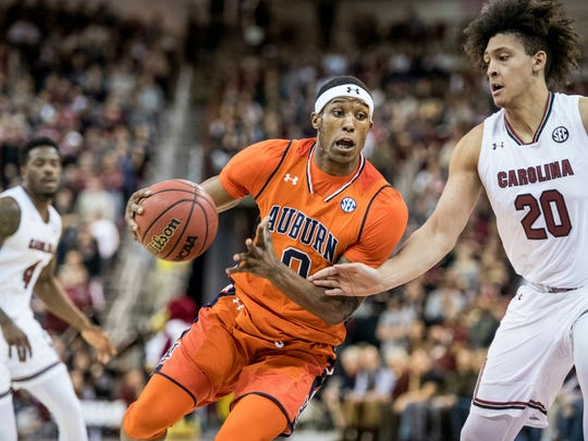 Auburn forward Horace Spencer (0) drives to the hoop against South Carolina forward Alanzo Frink (20) during the first half of an NCAA college basketball game Tuesday, Jan. 22, 2019, in Columbia, S.C. (AP Photo/Sean Rayford)