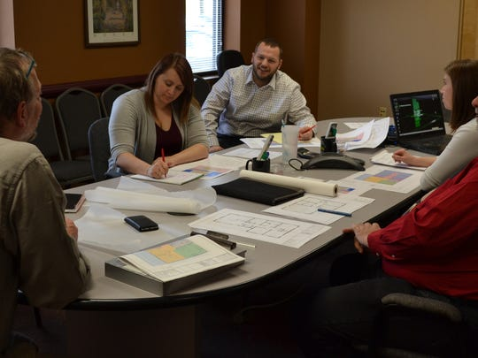 APD architects meet with Habitat for Humanity of Ontario County representatives on the new house design.