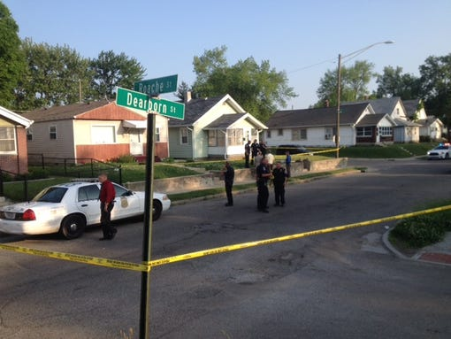 The scene near 25th and Dearborn streets, where an officer was shot and was in good condition Friday.