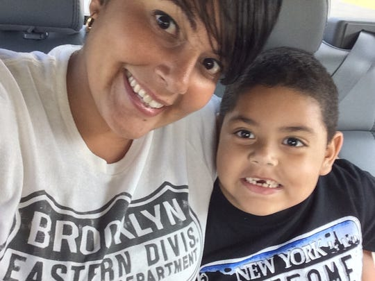 Linette Sanchez, shown with her son, is the executive assistant to Jeff Kiel, FLORIDA TODAY's president and publisher.