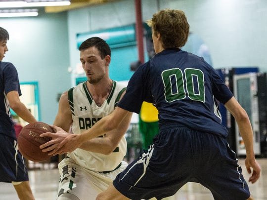 Salisbury School's Martin Abraham (42) moves the ball during a game against Gunston on Wednesday, Feb. 14, 2018.