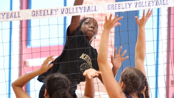 Nanuet's Gabby Faulcon jumps for a kill shot during