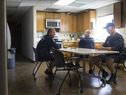 Firefighter Mike Walsh (from left), firefighter Dave Martin and Capt. Jan Shank relax in the kitchen at Scottsdale Fire Station 616 on Aug. 25, 2017.