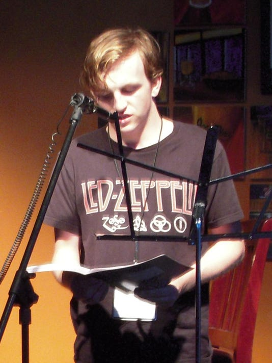 Brandon Pahl reads from his work at the youth open mic nightA