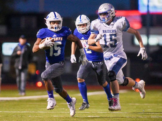 O'Gorman running back Iman Legesse (15) sprints down the sideline while being chased by Rapid City Stevens defensive back Jalen Johnson (15) during the first half of their high school football game on Friday, Oct. 13, 2017 at McEneaneyField in Sioux Falls.