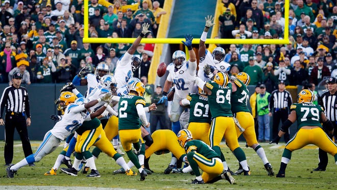 Green Bay Packers' Mason Crosby misses a field goal attempt at the end of an NFL football game against the Detroit Lions Sunday, Nov. 15, 2015, in Green Bay, Wis. The Lions won 18-16. (AP Photo/Mike Roemer)