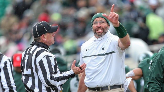 Michigan State offensive line coach Mark Staten talks to an official Nov. 19, 2016.
