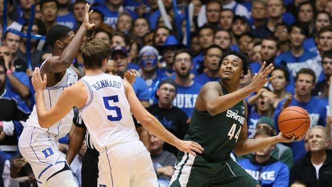 Michigan State forward Nick Ward (44) looks to pass the ball against Duke forward Amile Jefferson (21) and Duke guard Luke Kennard (5) in the second half of their game at Cameron Indoor Stadium. Mandatory Credit: Mark Dolejs-USA TODAY Sports
