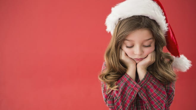 Many experts agree that there are ways to help kids navigate the holidays when unhappy circumstances mean the traditions they've grown accustomed to are changing.